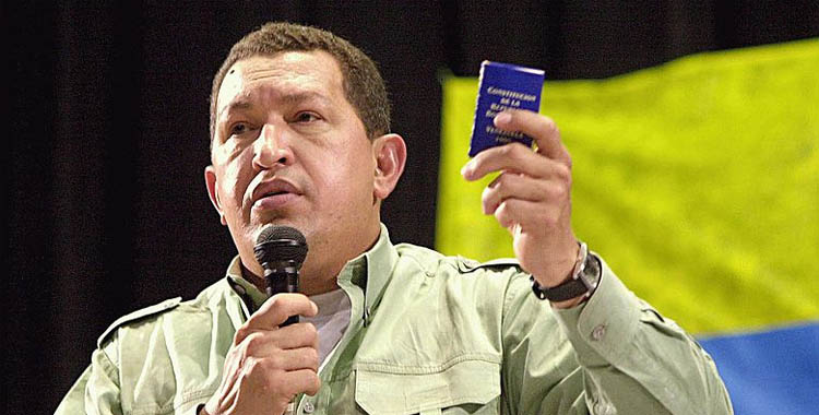 Hugo Chávez with the Venezuelan Constitution