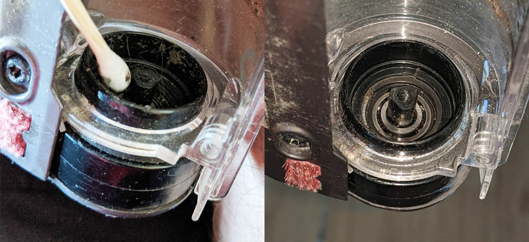 Cleaning behind the cog that drives the spinning brush bar in the motorised head of the Dyson DC35 handheld vacuum